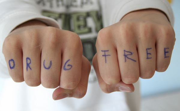 "Words ""Drug Free"" Written On Knuckles"