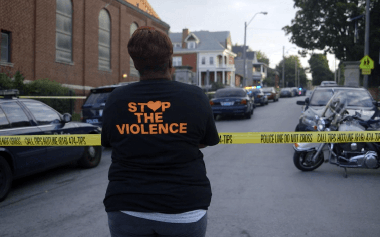 Mothers In Charge Founder Rosilyn Temple Standing at the police tape at a Kansas City Homicide Scene
