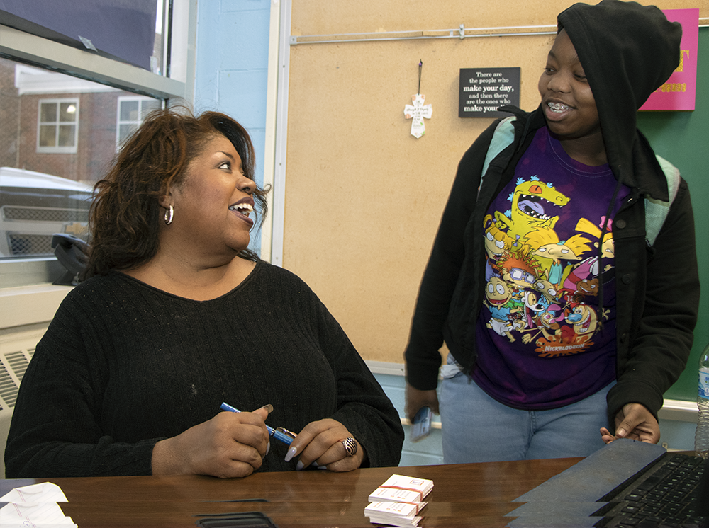 Hope Hangout Director Marva Moses clearly enjoys her work as she talks with a Ruskin High School student.