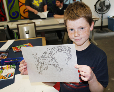Student draws his comic book hero